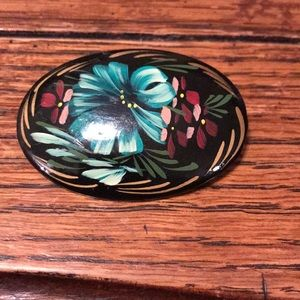Wooden painted brooch with blue flower